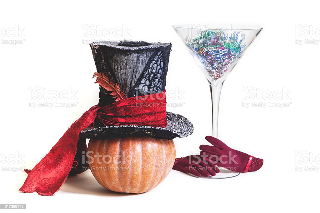 Magic hat and  huge glass of pumpkin stock photo