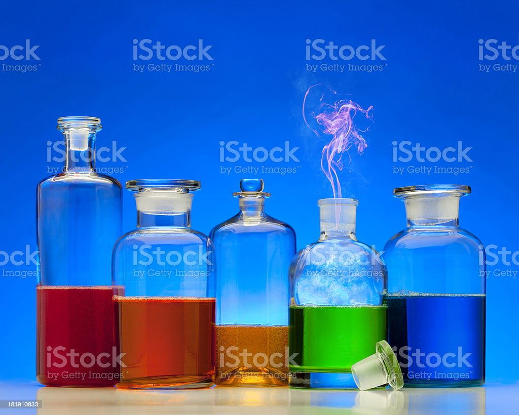Magic Potion Bottles with cloud rising out. stock photo