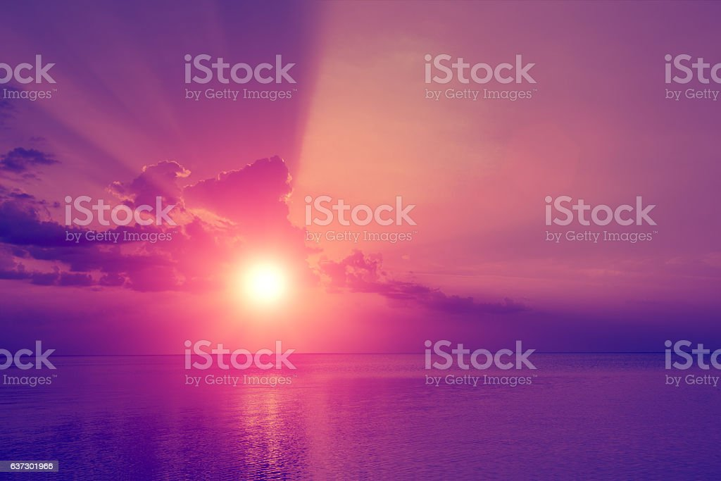 Magic purple sunset over sea stock photo