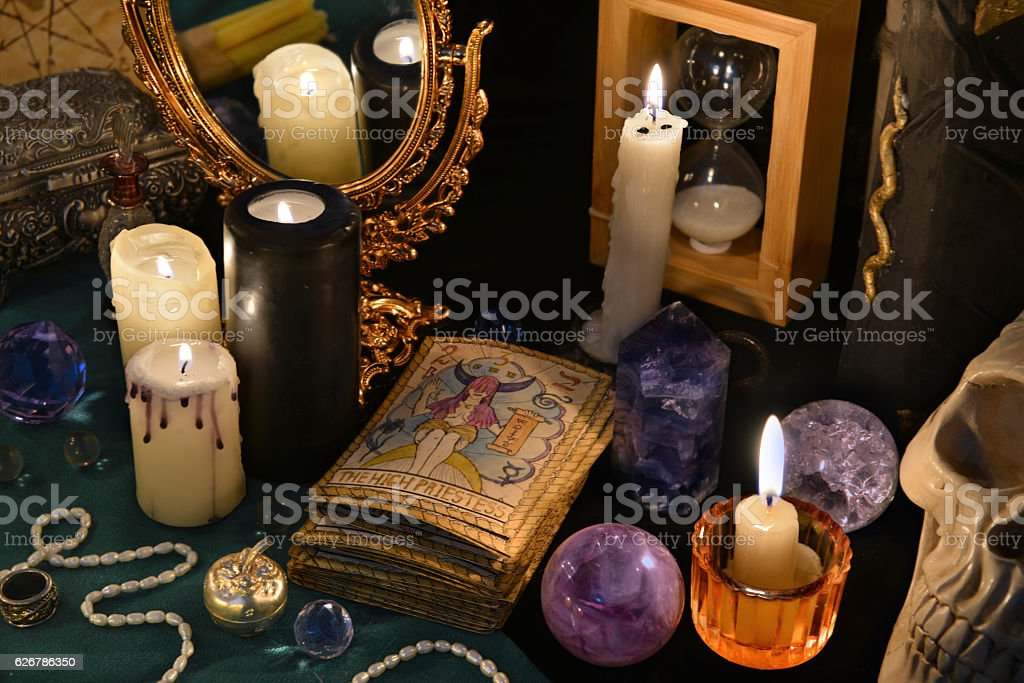 Magic still life with the Tarot cards, mirrow and candles stock photo