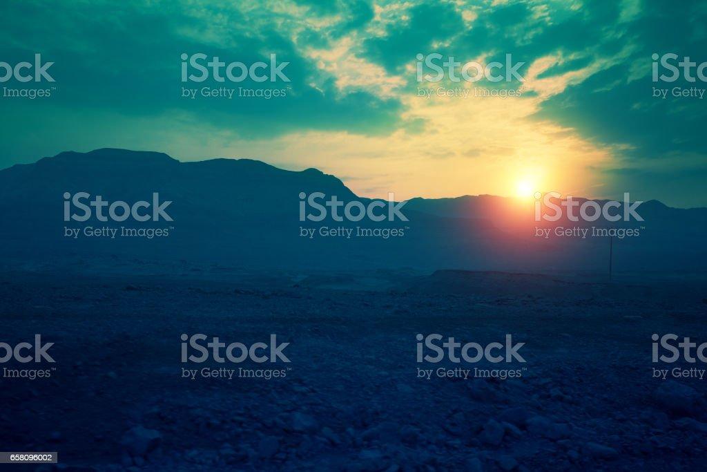 Magic sunset over mountain in Judaean desert, wild nature Israel. stock photo