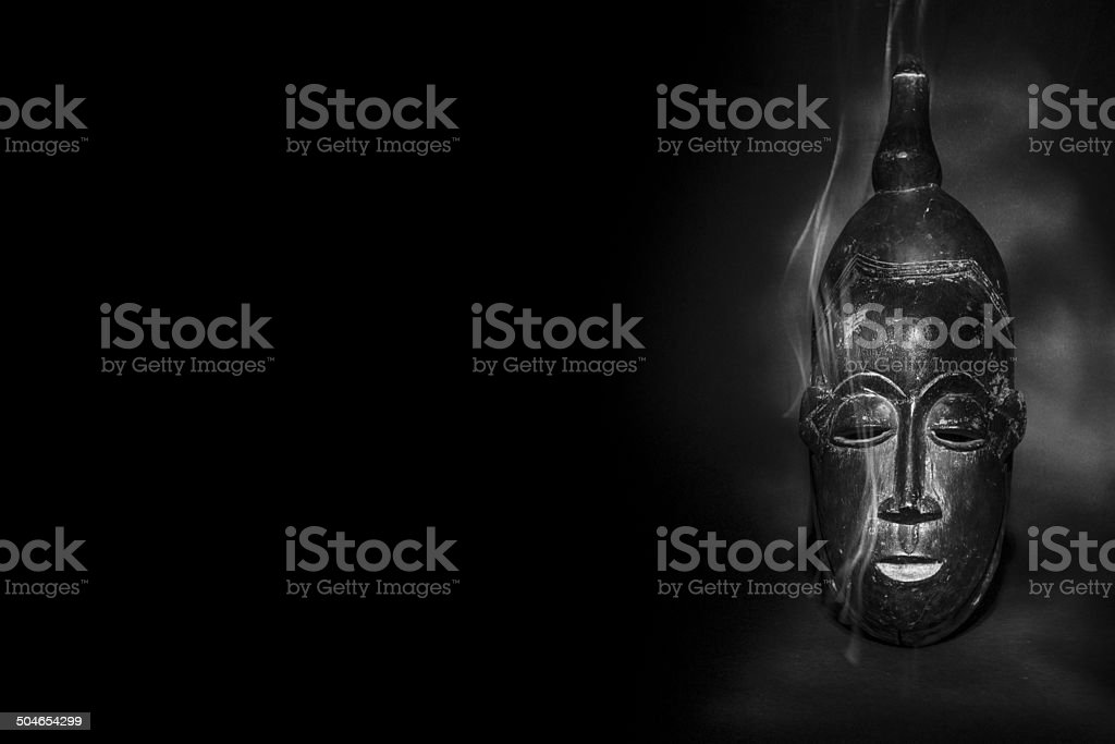 Magical african tribal mask with smoke stock photo