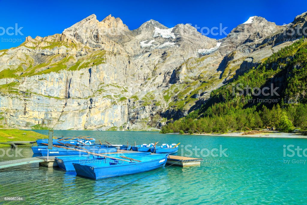 Magical alpine lake with high mountains and glaciers, Oeschinensee, Switzerland stock photo