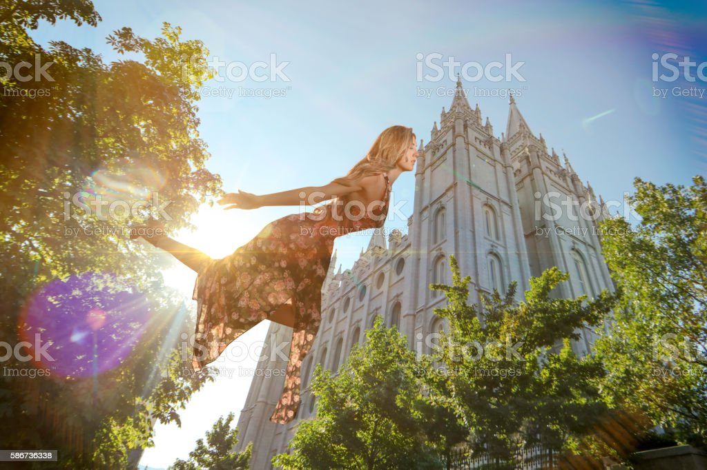 Magical floating woman floating near LDS template stock photo