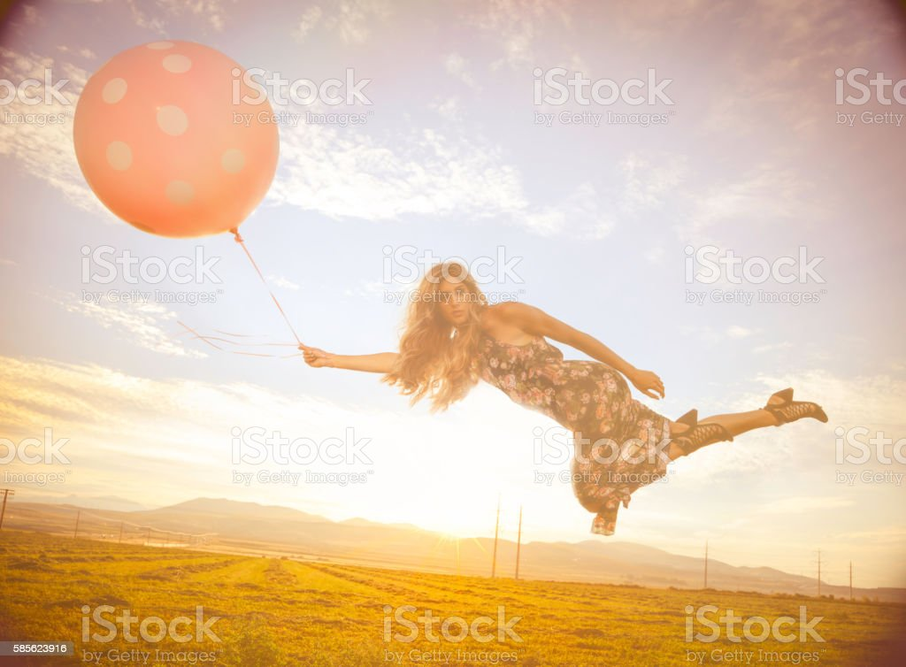 Magical floating woman stock photo
