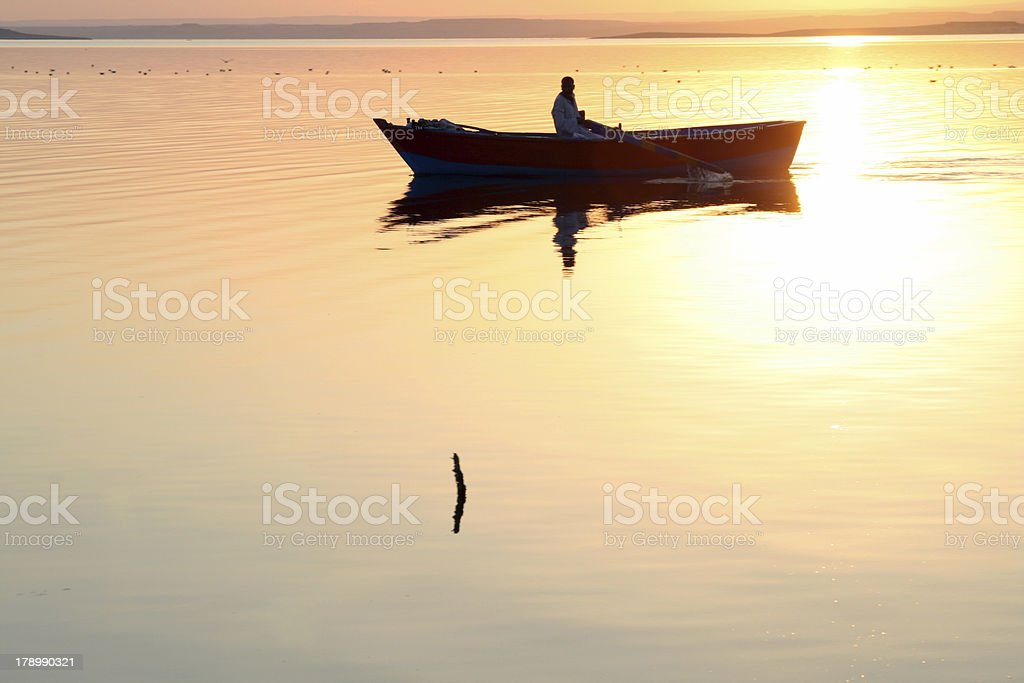 Magical Golden Sunset - Small Boat royalty-free stock photo