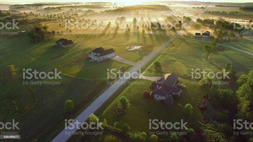 Magical sunrise through fog with long shadows and sunbeams stock photo