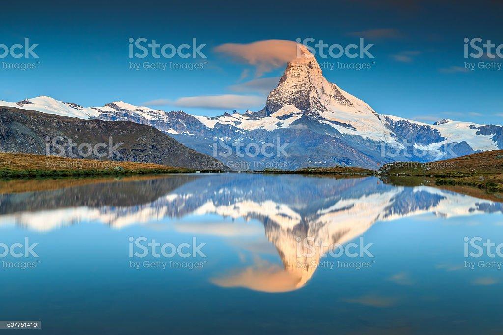 Magical sunrise with Matterhorn peak and Stellisee lake,Valais,Switzerland stock photo