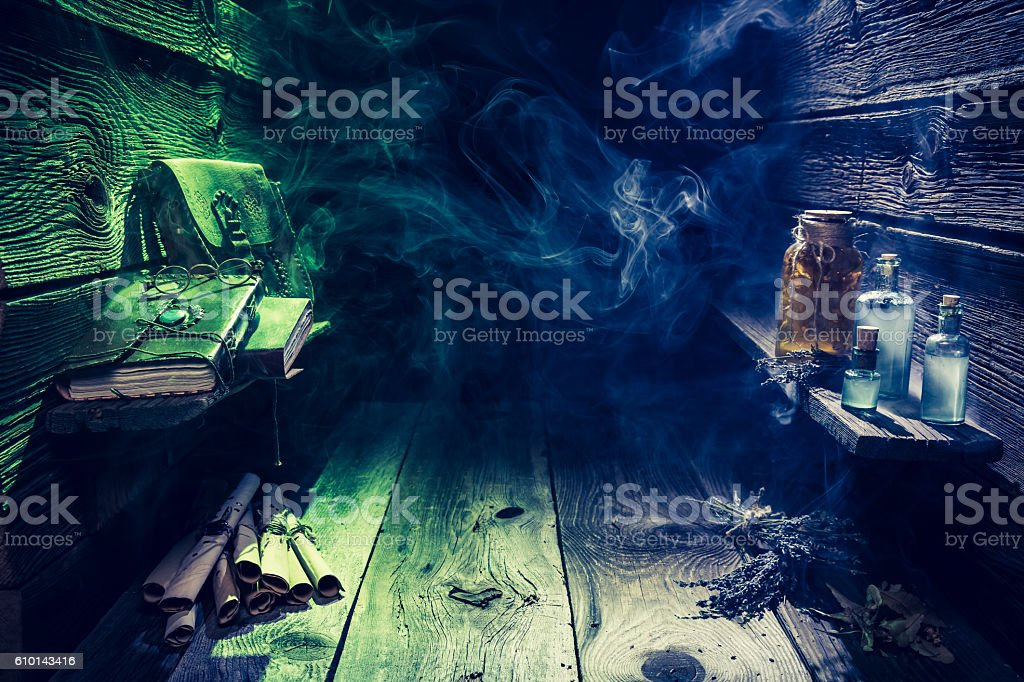 Magical witch hut full potions with copy space stock photo