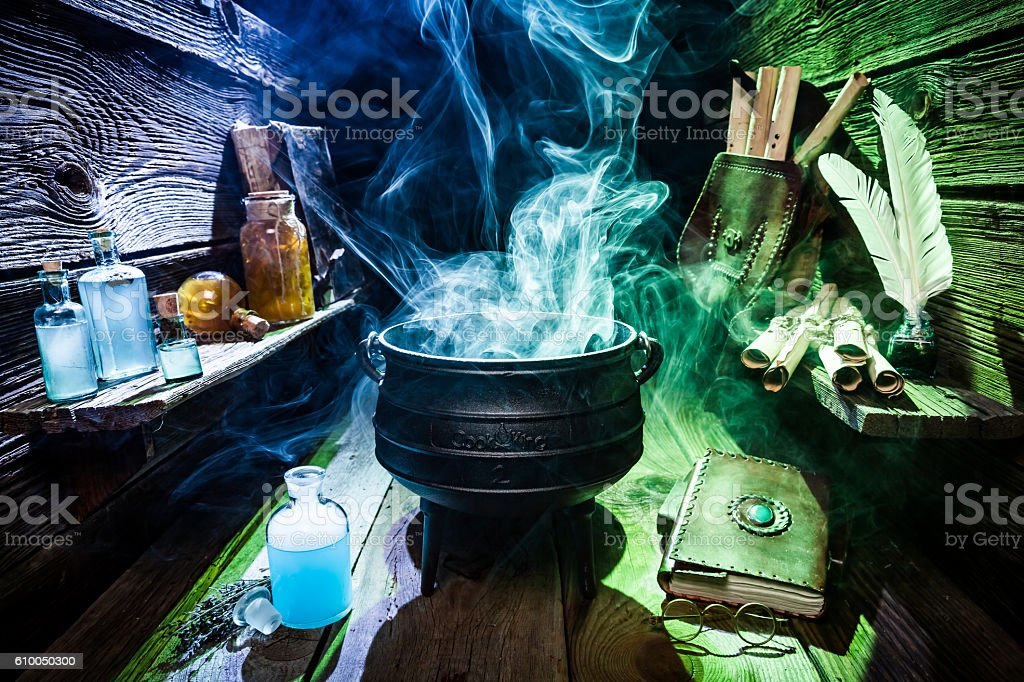 Magical witch workshop with blue and green smoke for Halloween stock photo