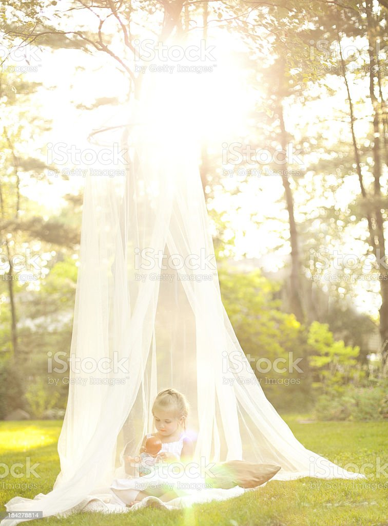 Magical. Young girl under tree in Canopy royalty-free stock photo