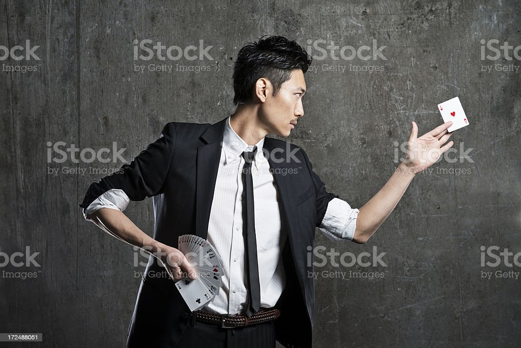 Magician doing card tricks stock photo