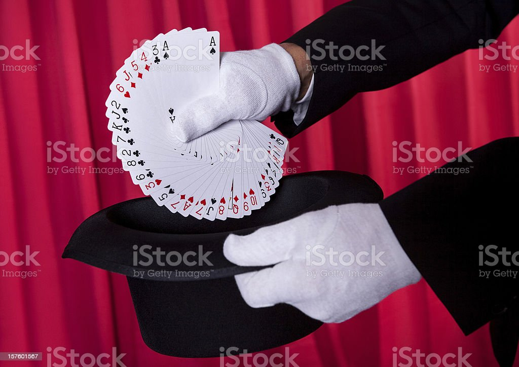 Magician Hand Holding Fanned Deck Of Cards stock photo