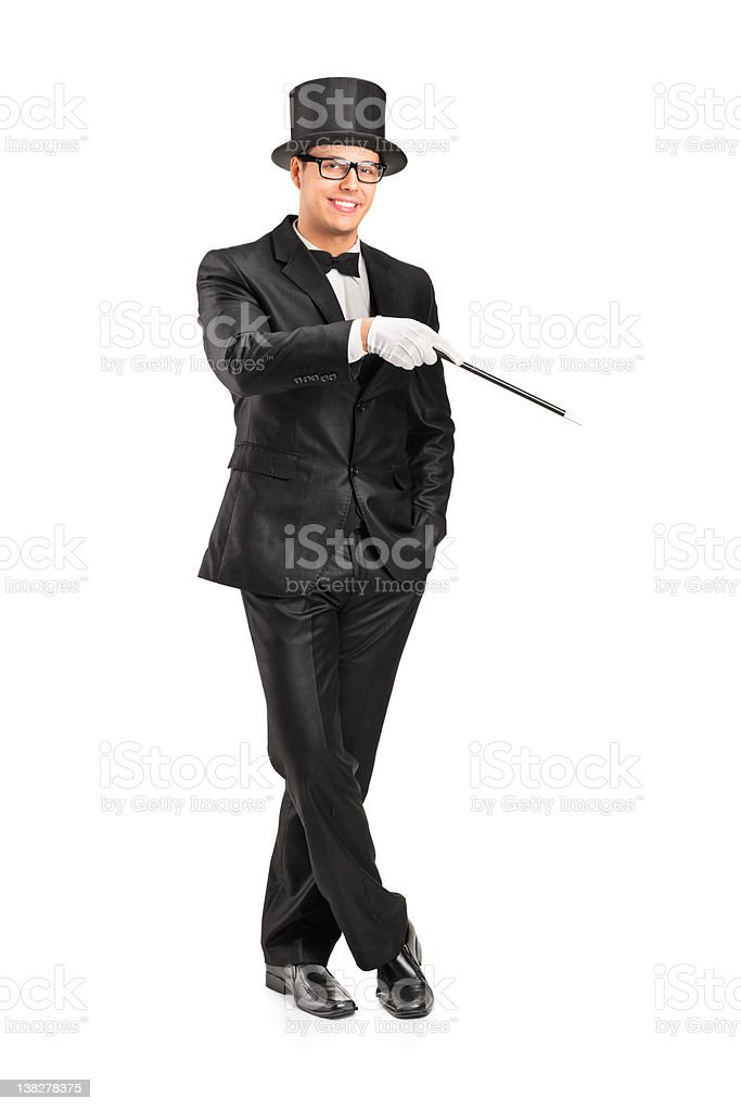 Magician holding a magic wand posing royalty-free stock photo