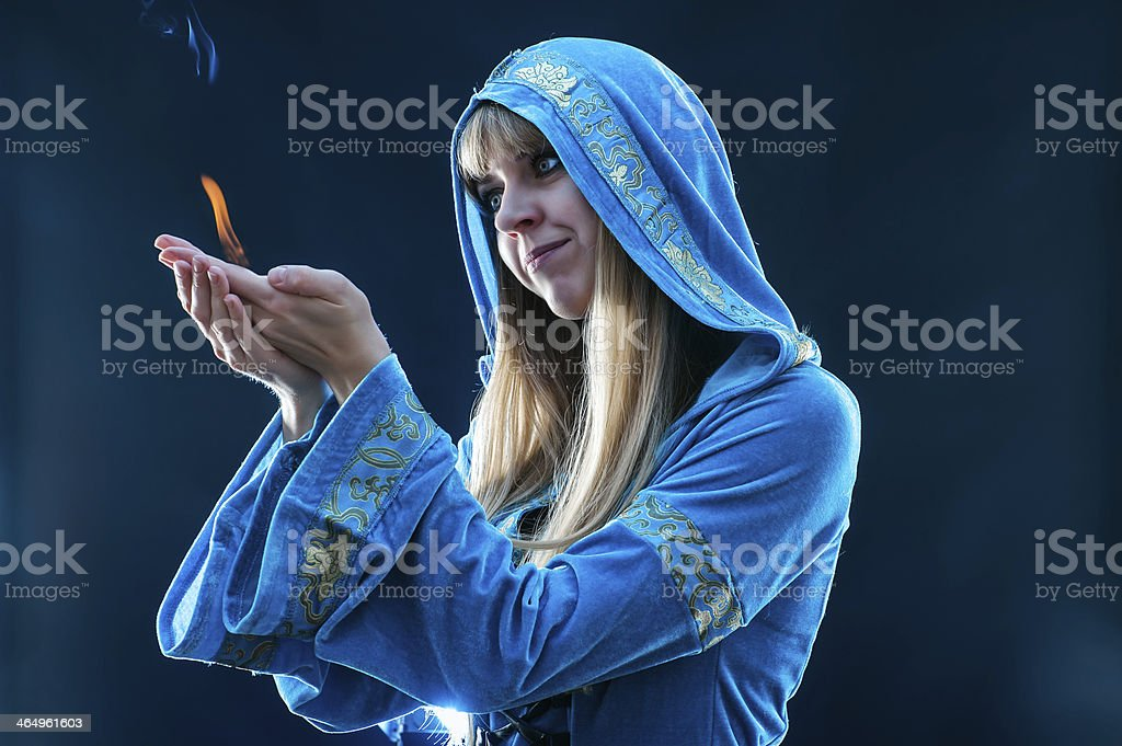 magician holding flame royalty-free stock photo