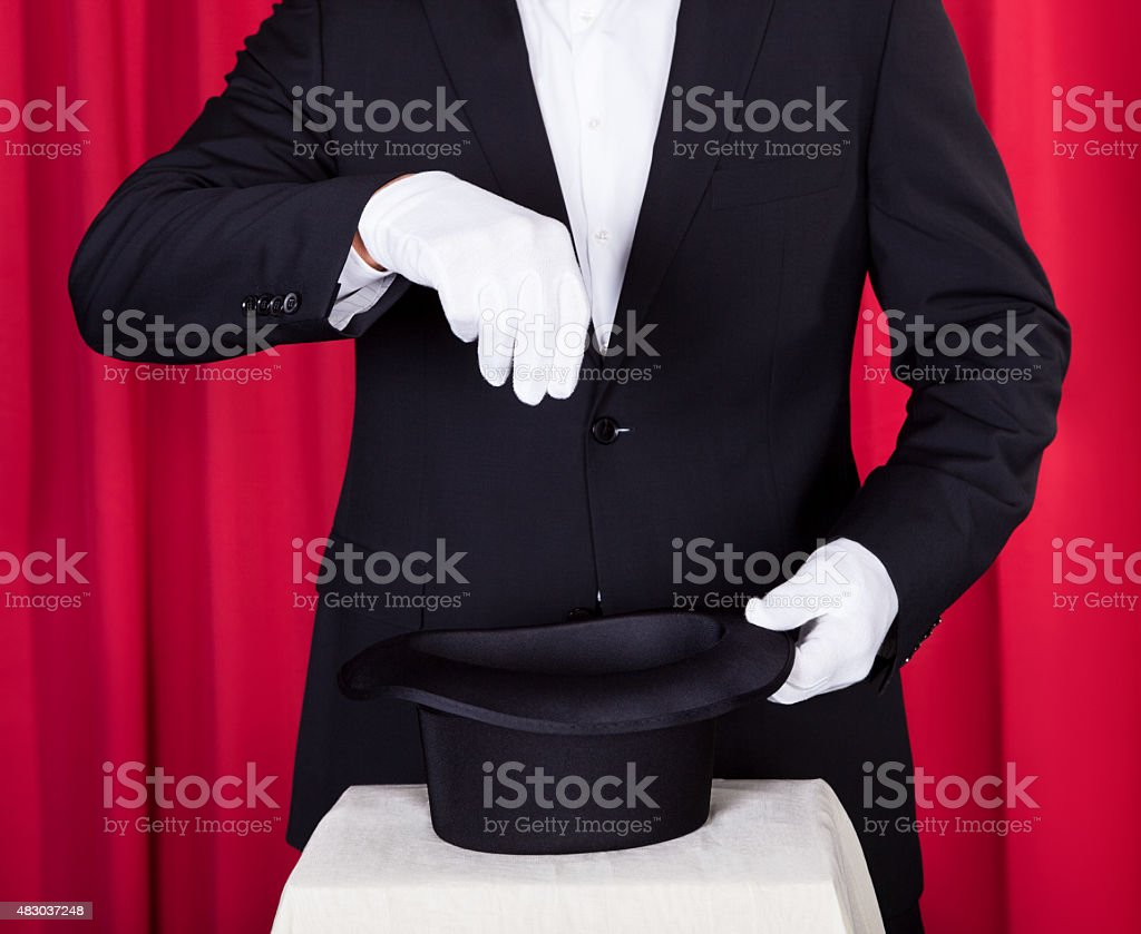 Magician In A Black Suit stock photo