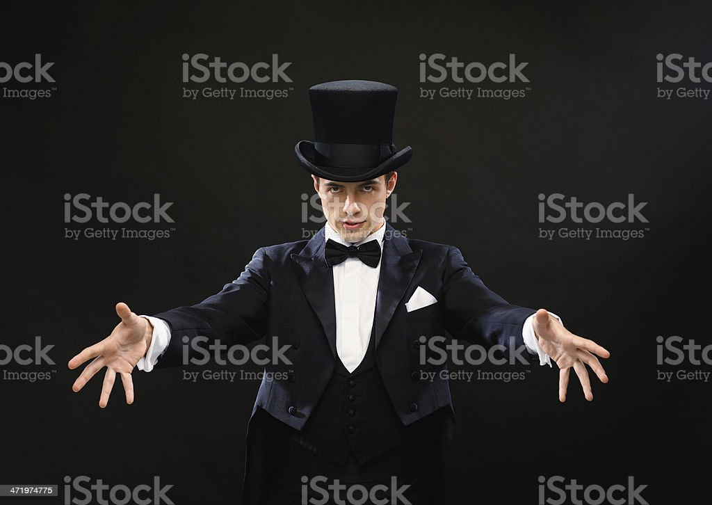 magician in top hat showing trick stock photo