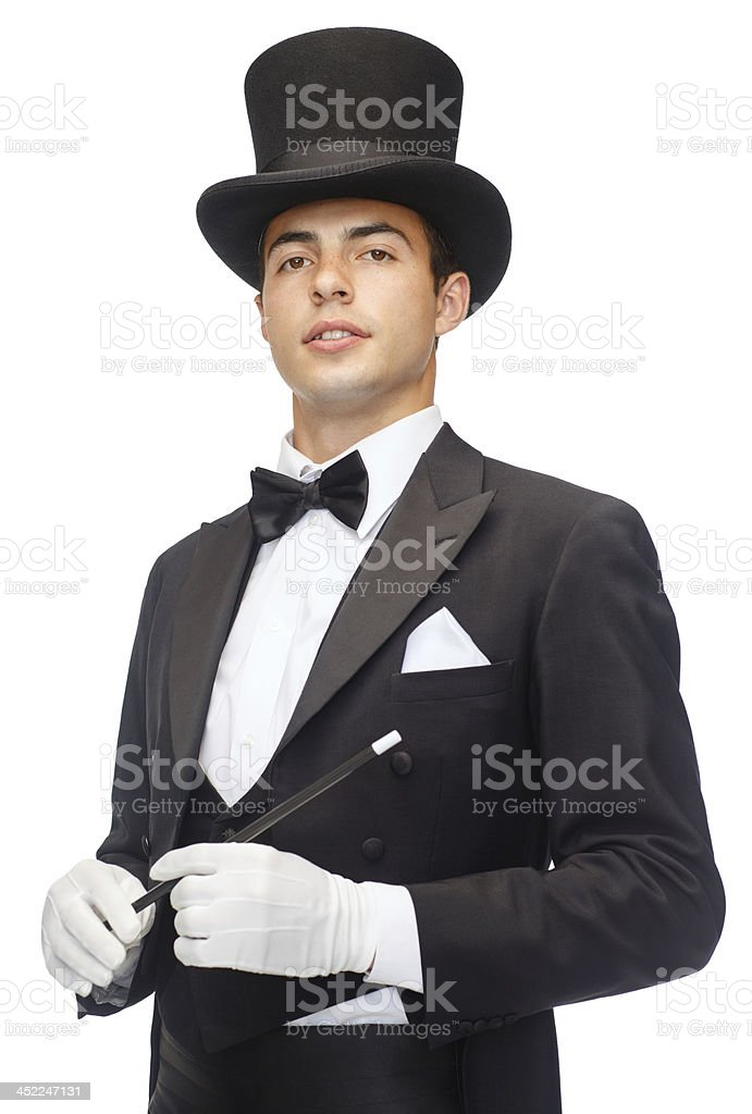 magician in top hat with magic wand stock photo