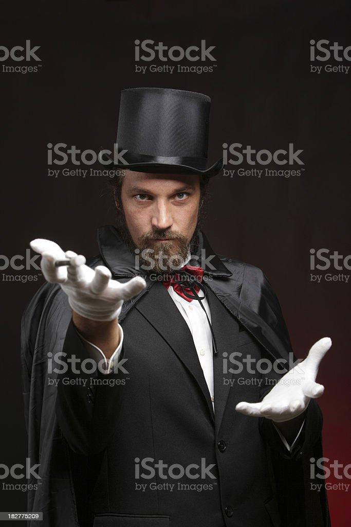 Magician performing tricks stock photo