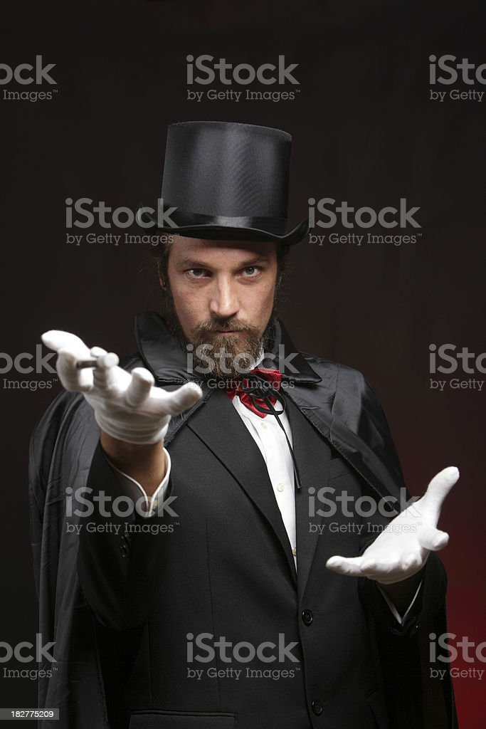 Magician performing tricks stock photo