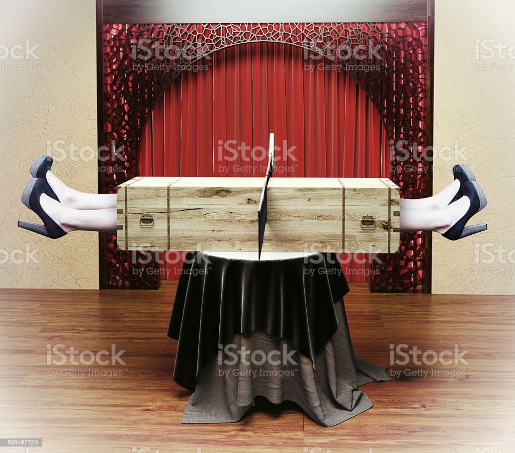 Magician sawing a woman stock photo