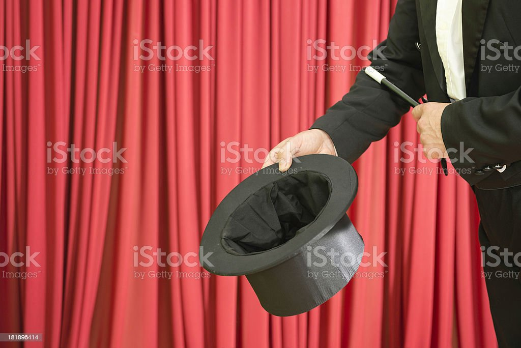 Magician showing empty top hat royalty-free stock photo