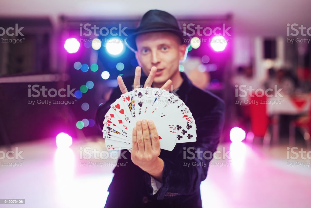 Magician showing trick with playing cards. Magic, circus stock photo