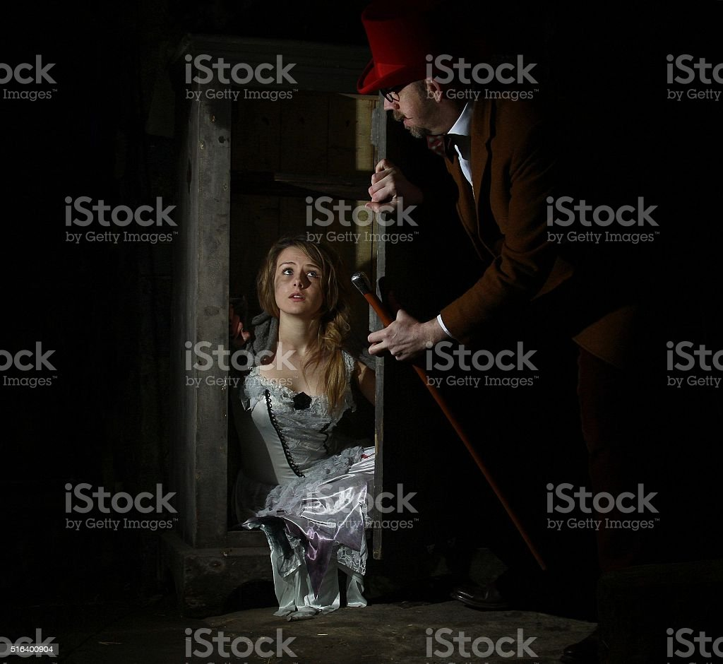 magician  with assistant stock photo
