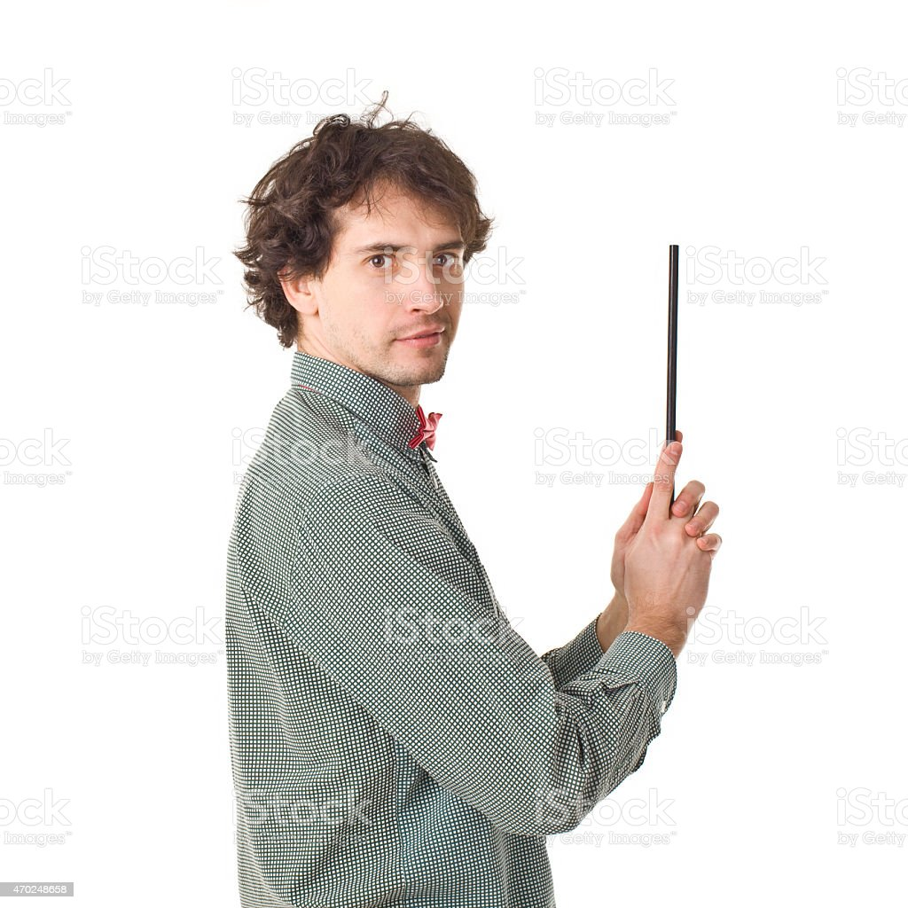 Magician With Red Bow Tie And Magic Wand. stock photo