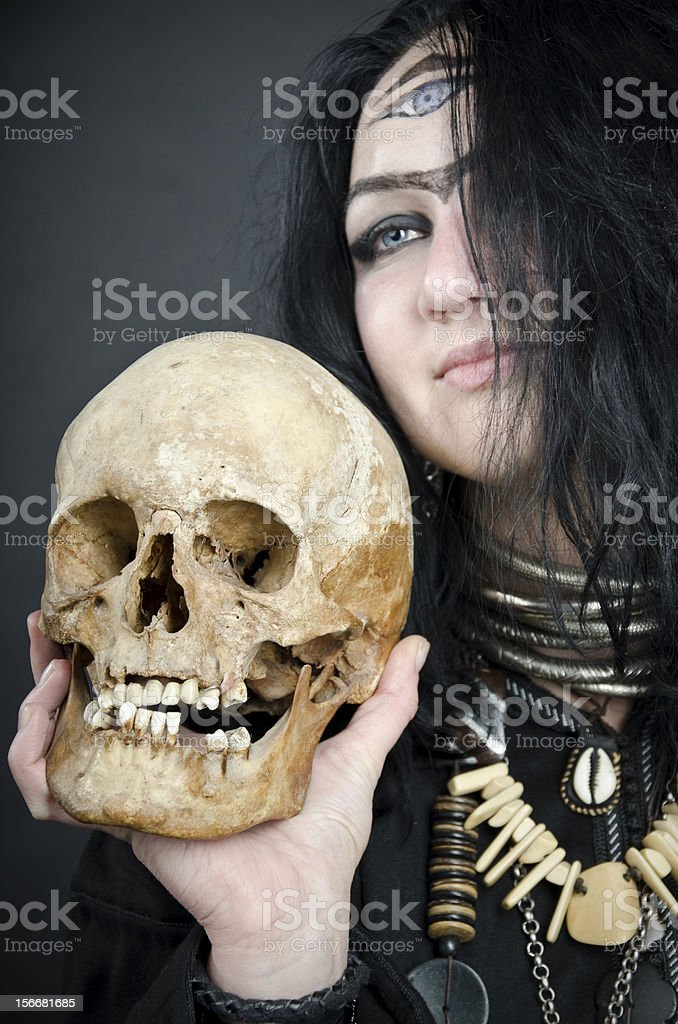 Magician with skull royalty-free stock photo