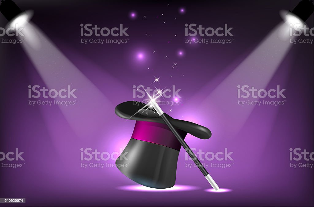 Magicians hat and wand on stage lighting reflectors stock photo