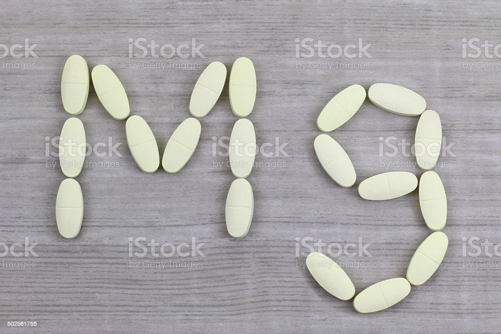 Magnesium tablets in a shape of Mg alphabet stock photo