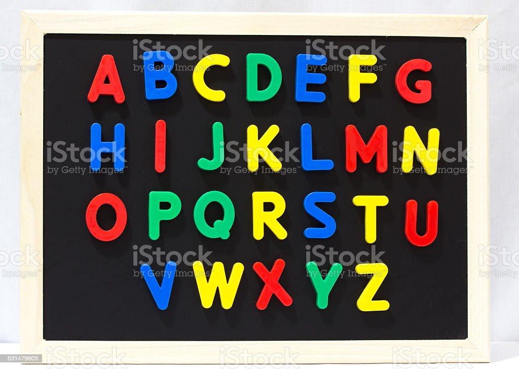 Magnet plastic alphabet on blackboard stock photo