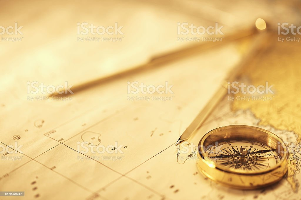Magnetic and Drawing Compass on a Map stock photo