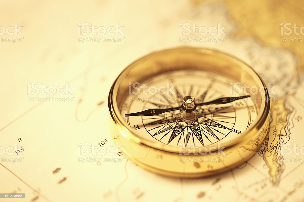 Magnetic Compass on a Map royalty-free stock photo
