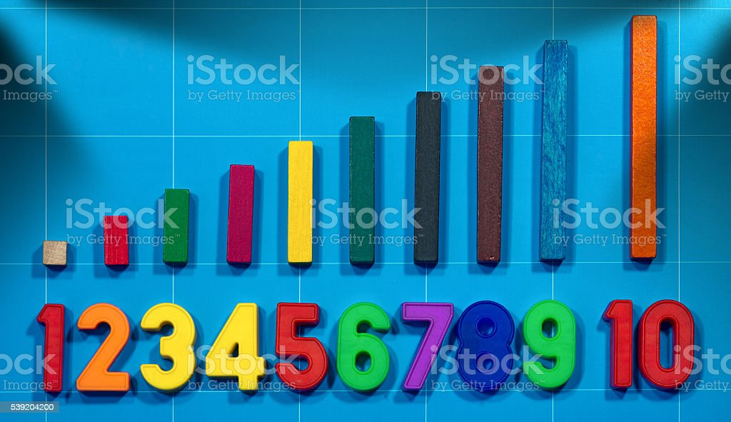 Magnetic Numbers and Wooden Colorful Pieces stock photo
