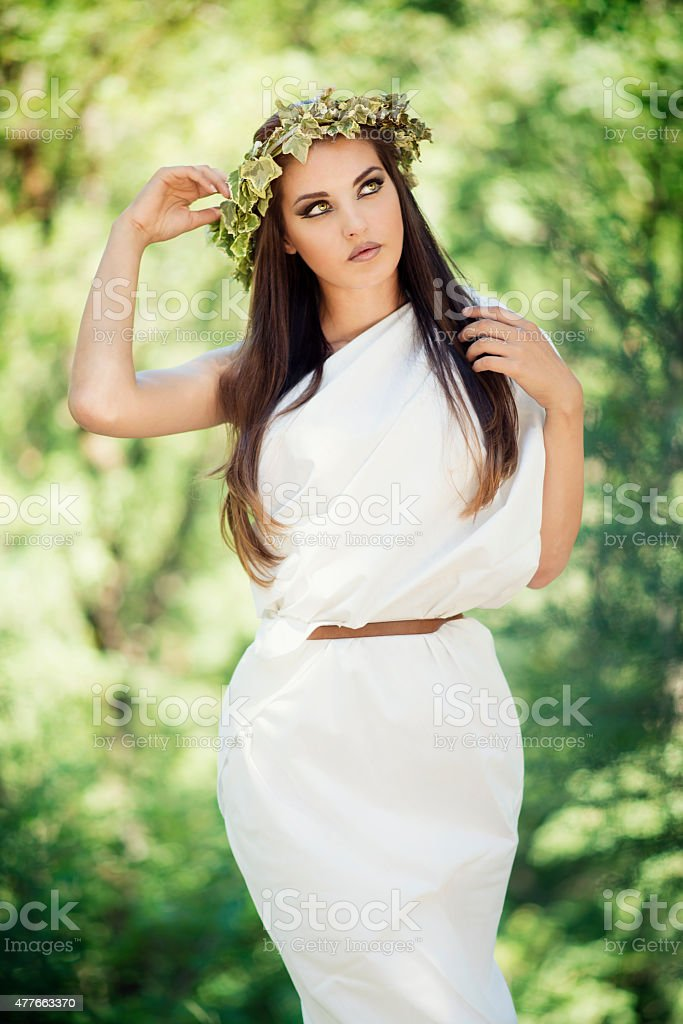 Magnificent Beautiful Girl with Wreath on Head Dressed like Goddess stock photo