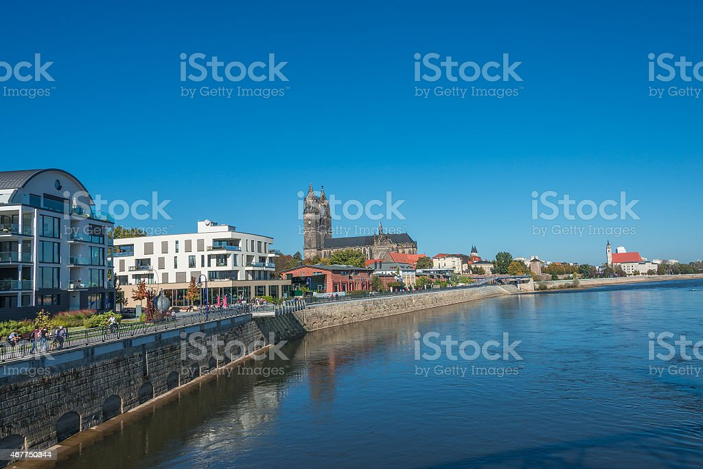 Magnificent Cathedral of Magdeburg at river Elbe and new town stock photo
