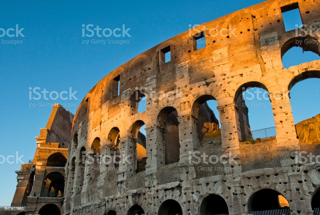 magnificent Colosseum in the first rays of sun stock photo