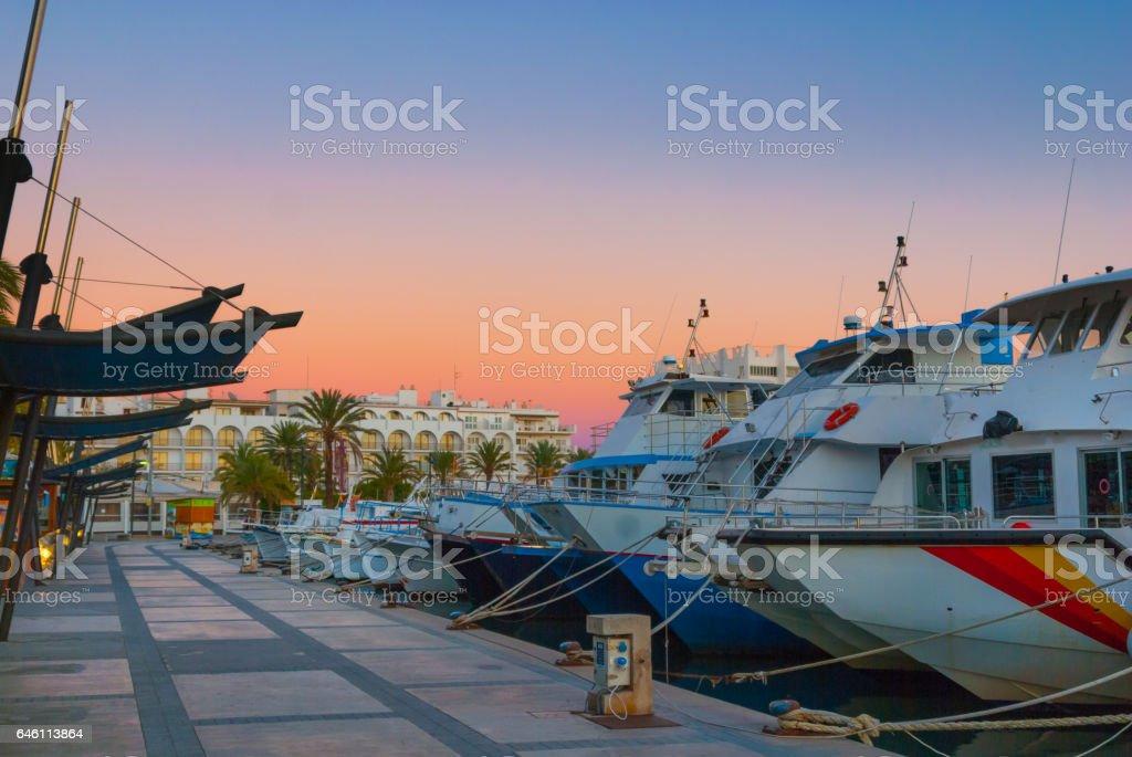 Magnificent magenta sunset color in marina harbor. stock photo