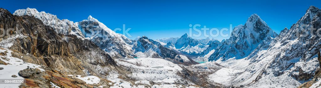 Magnificent mountain panorama across remote Himalayan peaks Everest NP Nepal stock photo