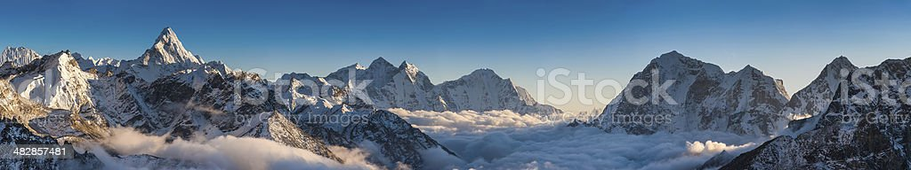 Magnificent mountain panorama snowy peaks high above clouds Himalayas Nepal royalty-free stock photo