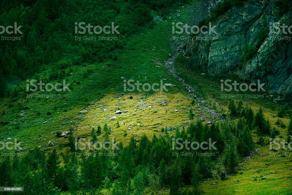 Magnificent scene in the French alps mountain a river flowing stock photo