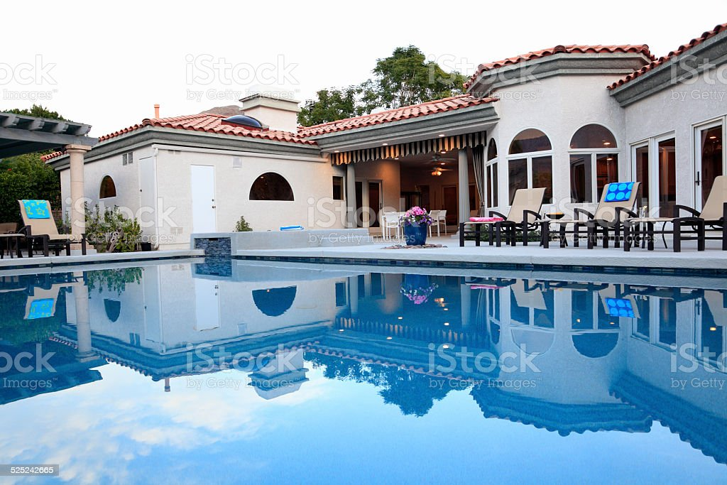 Magnificent Spanish Home Reflected In Pool stock photo