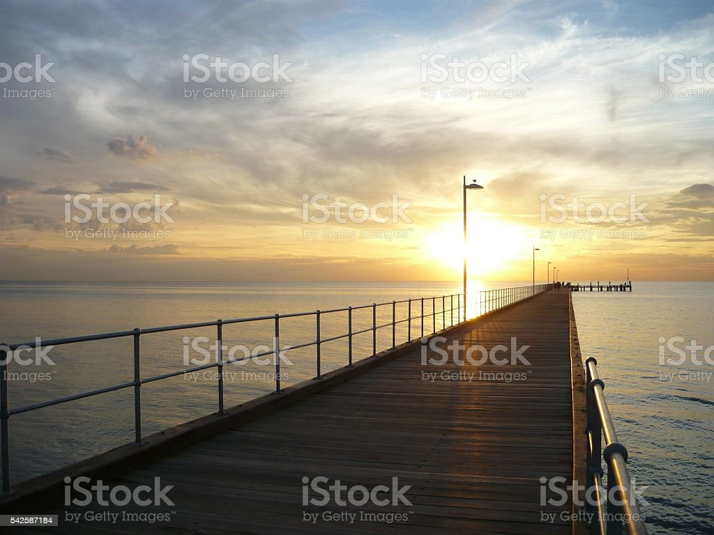 Magnificent sunset by the pier stock photo