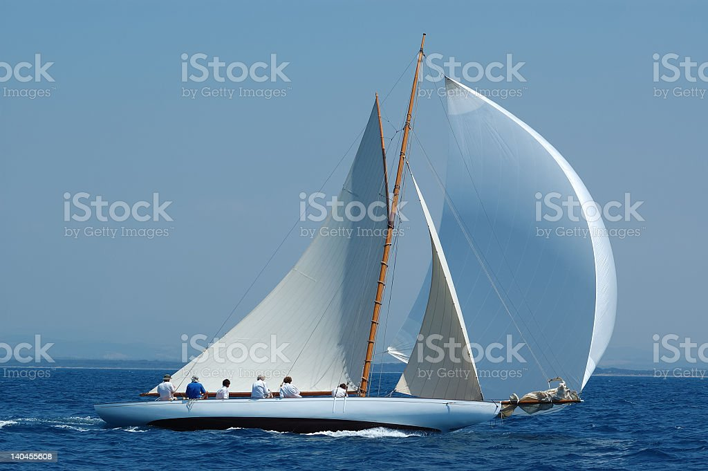 Magnificent white luxury sailboat with gennaker stock photo