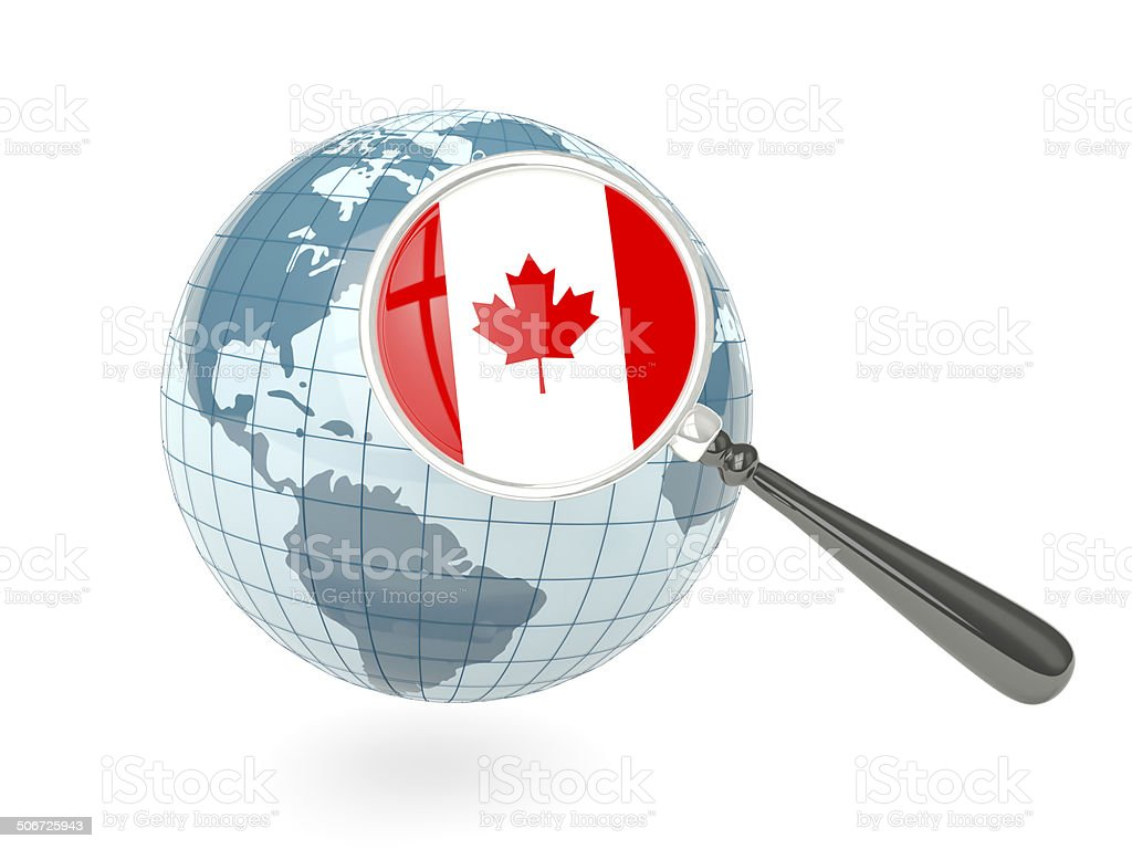 Magnified flag of Canada with blue globe stock photo