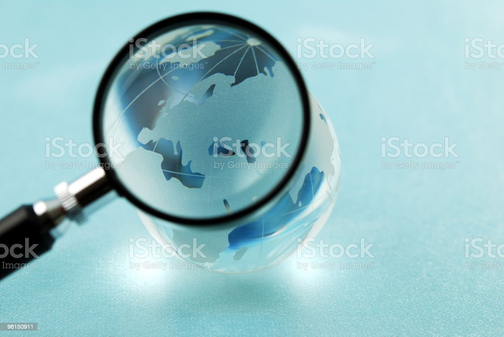 Magnified glass globe royalty-free stock photo