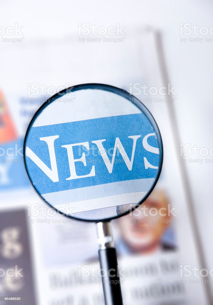 A magnified newspaper on a white background royalty-free stock photo