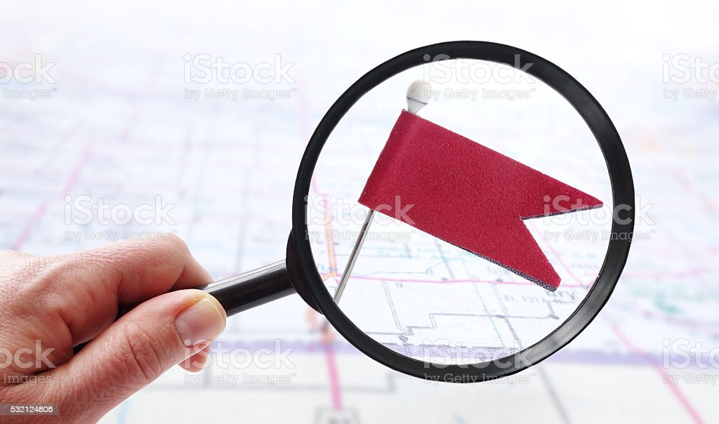 Magnified pin flag stock photo